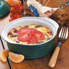 """Mini Egg Casserole Recipe -For a hearty breakfast treat, Lynn Stephens of Hermann, Missouri tops hash brown patties with eggs, cheese and vegetables. """"This savory casserole can be prepared the day before ad popped into the oven in the morning. It's the most popular breakfast dish at my bed-and-breakfast,"""" writes Lynn."""