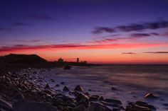 Seascape photography - Point Judith Light at Dawn. A fine art photograph of the rugged coastline of Rhode Island guarded by the Pt Judith Li...