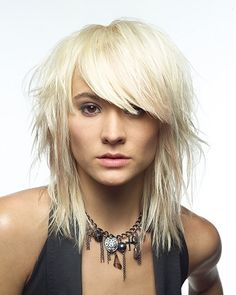 A long blonde straight choppy shaggy Modern hairstyle by Saks