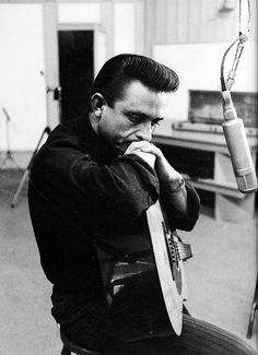 Johnny Cash in the studio, 1959. Following his four-year tenure at Sun Records, Cash jumped to Columbia in 1958. Photographed by Don Hunstein.