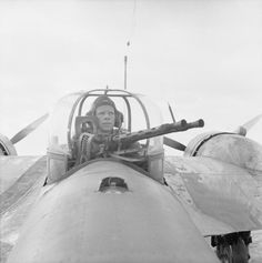 ROYAL AIR FORCE NORTH AFRICA (E 8292)   The gunner of a Blenheim bomber, F/Sgt J Mitchell, in his turret, 12 February 1942. This aircraft was used as personal transport by Lt Gen Neil Ritchie, GOC 8th Army, for visiting units in the desert.