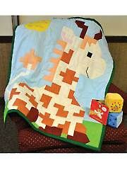 Applique Baby & Kids Patterns - Nigel Giraffe Quilt Pattern from Annie's Craft Store. Order here: https://www.anniescatalog.com/detail.html?prod_id=107572&cat_id=1721