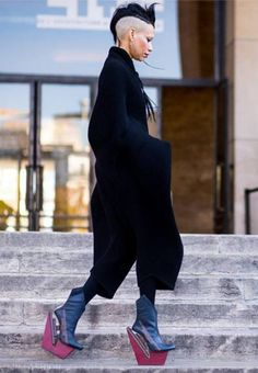 Lily Gatins wearing wool jumpsuit by Cunnington & Sanderson after Margiela during Paris Fashion Week featured in Vogue uk. Shoes by carolin holzhuber Photo - Daniel Grandl