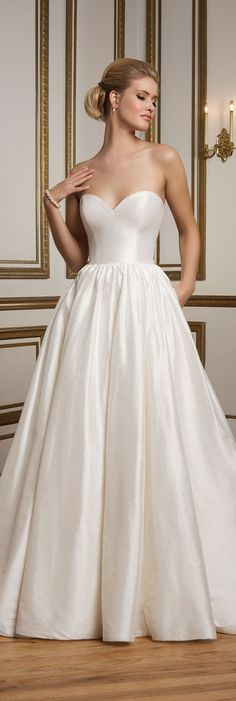 Justin Alexander Style 8825 - An elegant Silk Dupion ball gown with piped neckline and waistline, full gathered skirt and pockets create simplicity at its best.