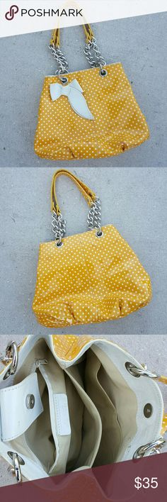 💯Authentic Roberta Gandolfi yellow polka dot bag Yellow and white polka dots with leather bow made in Italy genuine leather silver link chain strap there are a few marks on the front of the bag as seen in photos priced accordingly....🎶🎶🎶Itsy-bitsy teeny-weeny yellow polka dot🎶🎶🎶🎶.  I've received tons of compliments on this bag.  It's a classic 🌟🌟🌟 Roberta gandolfi Bags