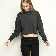 "NWT Brandy Melville cropped sweater. Brandy Melville. Cropped crewneck sweater. Gray/navy. ""Unfinished"" bottom cropped hem. Oversized/comfy. 63% polyester 34% rayon 3% spandex. SO cute & comfy. Bought in 2 colors and decided to only keep one. OS. NWT! Brandy Melville Sweaters Crew & Scoop Necks"