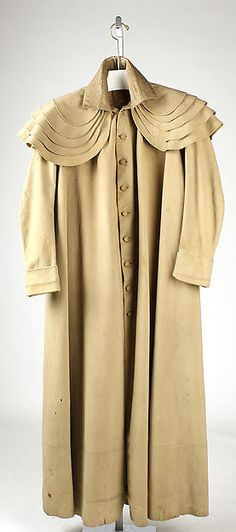 Coat (c. 1812) of wool, linen, and cotton.  Don't you just LOVE those shoulder capes?!