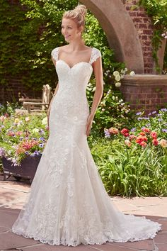 Wedding Dress out of Rebecca Ingram (Brenda)Brenda Layers of tulle and floral lace appliqués evoke antique romance in this fit-and-flare gown, featuring a sweetheart neckline and scalloped hem. Finished with corset closure. Detachable lace cap-sleeves sold separately.
