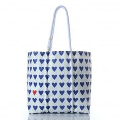 "Heart Pop Tote! The perfect way to say ""You're my one and only."" A single red heart stands out in a sea of blue on our recycled sailcloth tote. The print extends to the back, but there is only one red heart. The only place to find a second one is on the coordinating wristlet. Full of sentiment, this dependable tote can also be filled with beach items, knitting projects, gardening tools and anything else that someone special finds appealing."