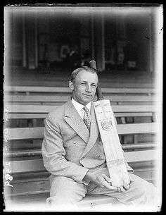 """Don Bradman with his """"Don Bradman"""" brand Sykes bat, ca. 1932 / by Sam Hood Format: Glass photonegative Notes: Find out more about our passion for cricket at Discover Collections - Cricket in Australia www.sl.nsw.gov.au/discover_collections/society_art/cricke... From the collections of the Mitchell Library, State Library of New South Wales www.sl.nsw.gov.au Persistent url: http://acms.sl.nsw.gov.au/item/itemDetailPaged.aspx?itemID=50717"""