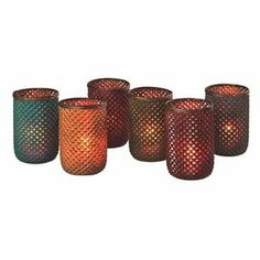 """Craft a charming dining table centerpiece or cast a warm glow atop your entryway console with these glass candleholders, showcasing a rich hue and textured details.  Product: set of 6 candleholdersConstruction Material: GlassColor: MultiFeatures: Machine made   Dimensions: 4.134"""" H x 6.89"""" Diameter  Accommodates: (1) Tealight candle each - not included Note: Price includes one of each style Cleaning and Care: Hand wash"""