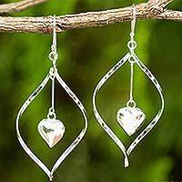 Discover unique handcrafted treasures. Every purchase will help UNICEF save and improve children's lives and help support talented artisans. Sterling silver dangle earrings, 'Heart Pendulum'