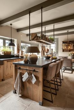 Table attached upside down to ceiling - a simple way of adding extra storage Industrial Kitchen Design, Kitchen Room Design, Kitchen Interior, Kitchen Decor, Kitchen Ideas, Kitchen On A Budget, New Kitchen, Küchen Design, House Design