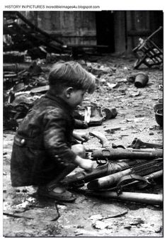 """""""German child playing with abandoned weapons, Berlin, Germany, Ww2 Pictures, Ww2 Photos, Rare Photos, History Online, World History, Mundo Cruel, German Boys, War Photography, Trauma"""