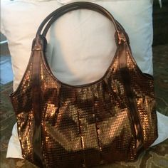 ✨NWT FLASH SALE ✨ French connection tote Amazing bronze shoulder bag from French connection never been used livens up a classic outfit ! This bag was shown in article in women's health such a cute bag !! Lots of room to hold all your stuff!! French Connection Bags Shoulder Bags