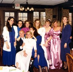 Sister Lisa is on the left, Lauren at center and Carolyn on the right.  All are wearing blue dresses.