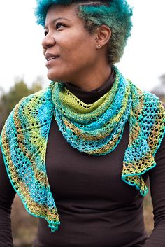 Each to Each pattern by Barbara Benson. A crescent shaped shawl with a watery theme and a gracious plenty of beads. Designed to work with a sock blank but you could use any fingering.