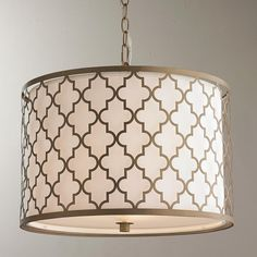 "Convertible Contempo Arabesque Drum Pendant Moroccan architectural details inspire the styling of the Contemporary Arabesque Collection. An Antique Silver or Brushed Gold arabesque metal cage surronds a crisp white fabric shade delivering clean and simple but interesting lines adding soft sophistication to your home. The frosted glass diffuser provides soft ambient lighting. Includes semi-flush option hardware. (14""Hx18.25""W)"