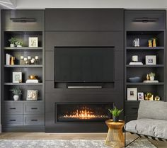 Custom living room wall unit with recessed TV and linear gas fireplace. Includes wall sconces, open shelving and closed drawers. Designed By Myers + Philippe Interior Design. Ikea Wall Units, Bedroom Wall Units, Modern Tv Wall Units, Living Room Wall Units, Dark Living Rooms, Living Room Modern, Modern Wall, Built In Tv Wall Unit, Wall Units With Fireplace