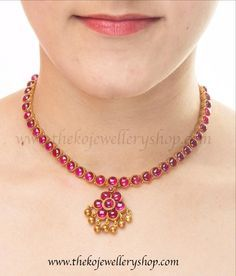 A classic design of south Indian temple jewellery this necklace has red kempu stones set singly in a closed setting. Cod all over India. Gold Temple Jewellery, Silver Jewellery Indian, Gold Jewellery Design, Gold Jewelry, Kerala Jewellery, Jewellery Bracelets, Ruby Jewelry, Craft Jewelry, Jewellery Shops