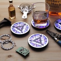 Marvel Iron Man 3 Arc Reactor Light-Up Coasters / Just like the Avengers protect us from interplanetary disasters, this set of four Marvel Iron Man 3 Arc Reactor Light-Up Coasters saves our table from being destroyed by beverages. http://thegadgetflow.com/portfolio/marvel-iron-man-3-arc-reactor-light-up-coasters/