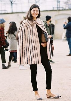 A ladylike cape is worn with cropped skinny pants and slingback flats