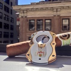 Macanudo. This cutter is like jewelry. Beautiful... I would actually carry this in my bag for him or offer it to a gentleman to use with his cigar, like a man offers a light to a woman...