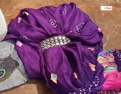 Indian Jewelry ---- A favorite silk bandhini (also referred to as bandhani) dupatta that I have had for more than 26 years. Bandhini is a type of tie and dye design. A lovely silver bracelet (tribal design) from Amrapali (Jaipur, Rajasthan).