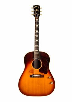 John Lennon's original 1962 J-160E Gibson Acoustic guitar. The guitar had been lost for over 50 years.