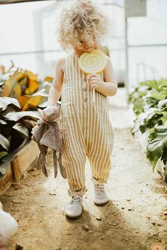 Row 10 baby boutique // greenhouse photoshoot // toddler photoshoot // toddler photoshoot prop ideas // Rylee and Cru pinstripe jumpsuit // shop.row10baby.com
