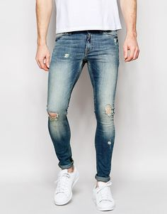 Image 1 of ASOS Extreme Super Skinny Jeans With Knee Rip Detail