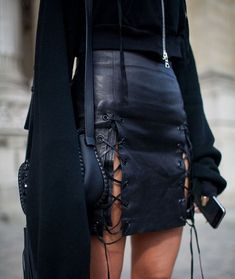 Leather lace-up mini skirt, black sweater with bell sleeves, and mini saddle bag. #kidoutfits