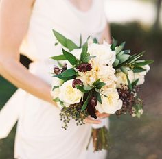 bridal bouquet: peonies, garden roses, eucalyptus, cornflower, and viburnum berries.