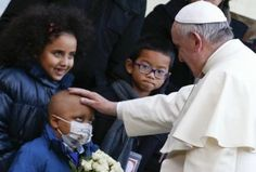 Pope blesses sick child as he visits Bambino Gesu children's hospital in Rome