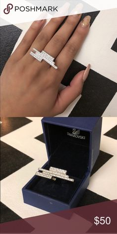 Swarovski Ring Size 7 Only worn a couple times.  The ring itself is in perfect condition but the box looks a little worn on the bottom from being stored away. Swarovski Jewelry Rings