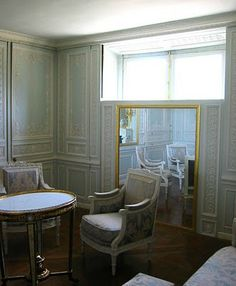 Petit Trianon: Boudoir, this room was lined with very simple boiseries with inset mirrors that at the turn of a crank in the room below, recede into the wall exposing the window on the east wall and the french doors to the terrace on the north wall.