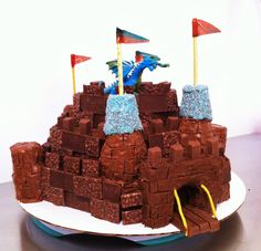 Cool dragon and castle cake, chocolate bar stones, rice crispy turrets