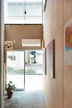 persimmon hills architects has converted an illegal sex shop in japan into a studio and gallery space that measures just 20 square meters.