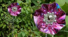 Fancy Pansies with upcycled CDs in garden 2 electronics with Upcycled Recycled Garden Flowers CD