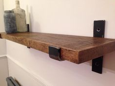 Solid oak shelf finished in Jacobean oak wax with hand crafted industrial brackets