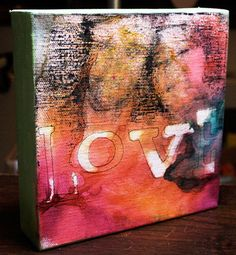 Canvas tutorial.  Stick on letters, spray wash paint/ink leaving some white space for the image transfer.  Transfer image and paint edges of canvas.  Love this idea!