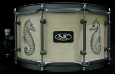 Hand burned Seahorses by the Butcher with white satin stain