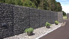 Gabion fence, with similar structure but more functions than gabion wall and gabion retaining wall. It is commonly made of welded gabions which has rigid and durable structure. Mesh Fencing, Garden Fencing, Fence Gate, Fence Panels, Gabion Retaining Wall, Gabion Baskets, Hillside Landscaping, Fence Styles, Privacy Walls