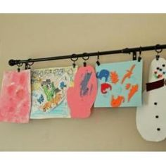 Curtain rod to hang children's artwork. From: Best Ideas and Products to Keep The Playroom Organized by Eden Godsoe
