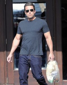 Bicep-man: The 42-year-old Hollywood star displayed his impressive new physique in a fitted t-shirt