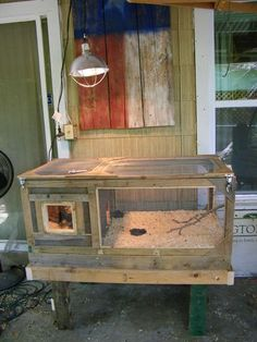 Chicken brooder with stand.