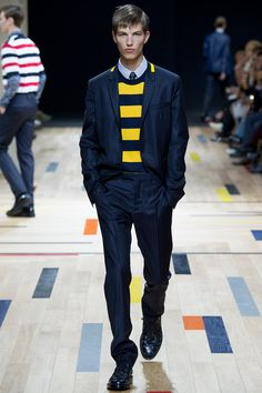 The yellow strip at the collar adds a refreshing look to the otherwise business looking pinstripes Dior Homme | Spring 2015 Menswear Collection | Style.com