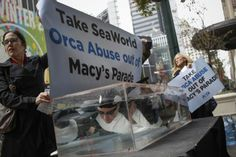 PETA activists demonstrate outside Macy's in Herald Square, New York (Reuters)