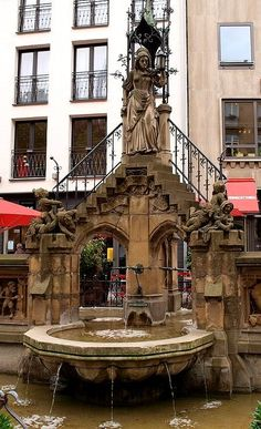 Heinzelmänchenbrunnen, Köln, Deutschland (by Einsiedler. on Flickr), every city in Germany has a fountain in the center of town usually in fron of the rathaus
