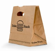 Packaging for the fast-food restaurant in New York City. Design by Paula Scher.